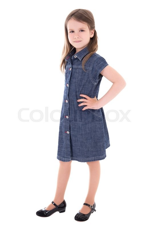 Stock image of 'cute little girl in denim dress isolated on white background'