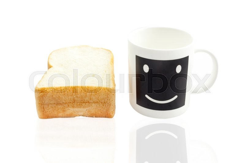 Stock image of 'Empty smile coffee cup or smile coffee mug and sliced bread isolated on white background'