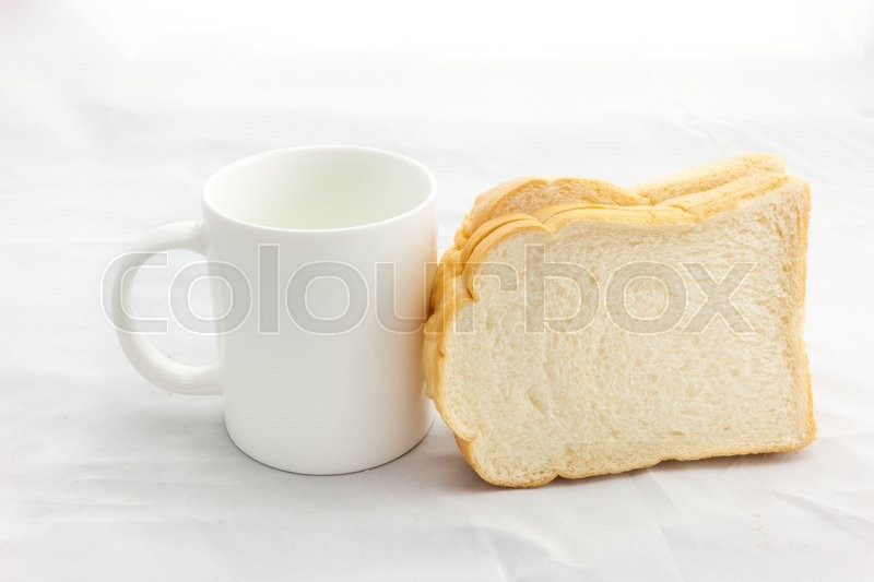 Stock image of 'Empty coffee cup or coffee mug and sliced bread isolated on white background.'