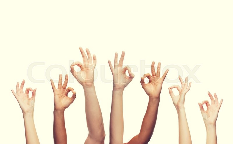 Stock image of 'gesture and body parts concept - human hands showing ok sign'