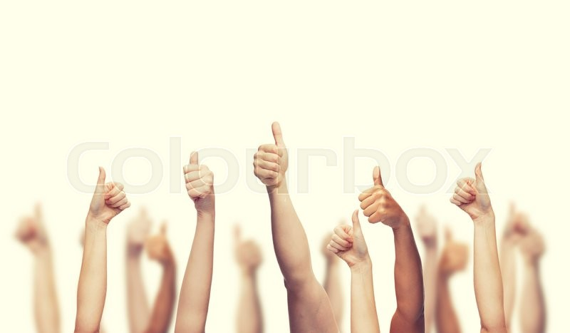 Stock image of 'gesture and body parts concept - human hands showing thumbs up'