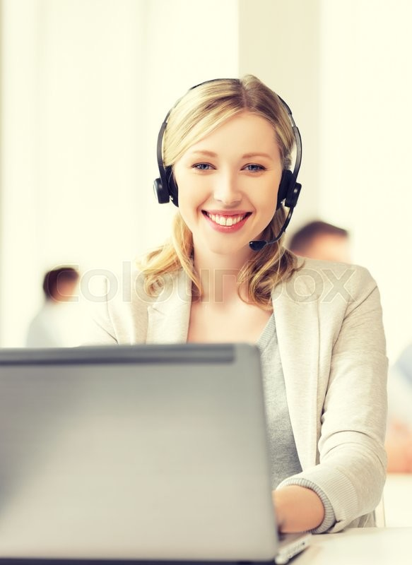Stock image of 'business and technology concept - helpline operator with headphones in call centre'