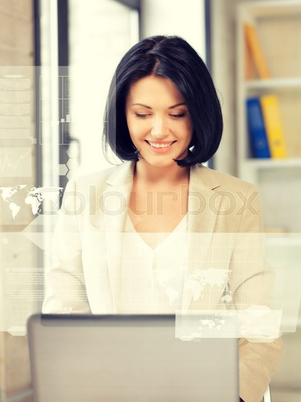 Stock image of 'picture of friendly businesswoman with laptop computer and virtual screen'