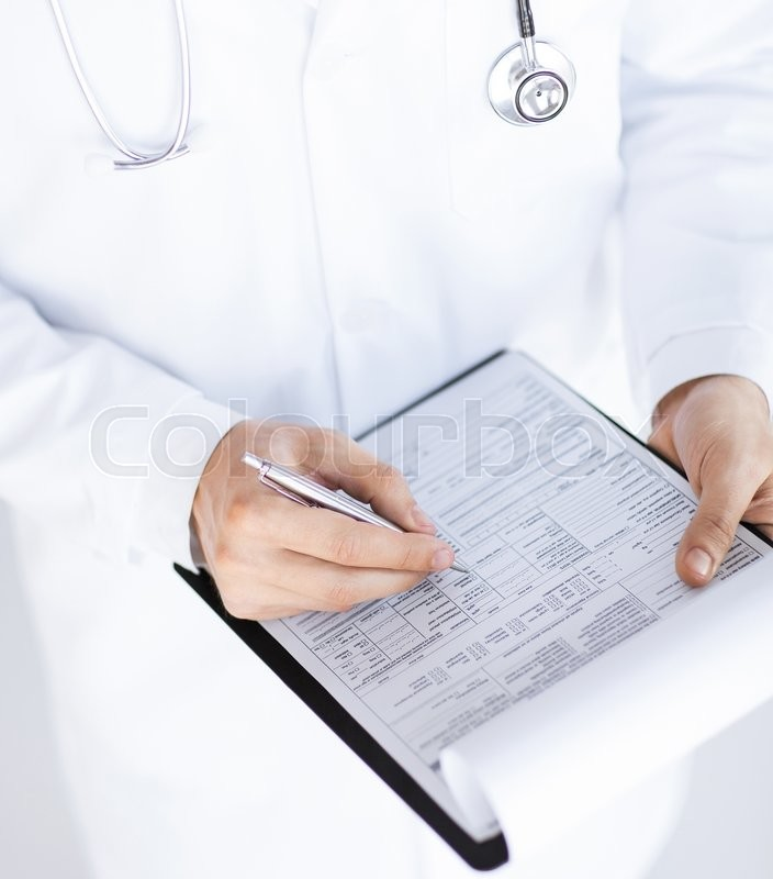 Stock image of 'close up of male doctor holding prescription paper in hand'