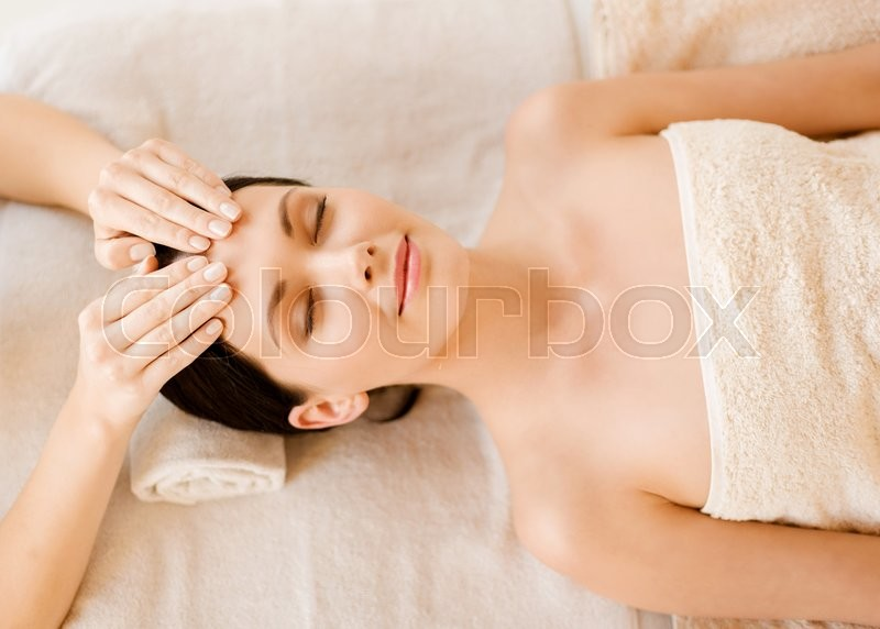 Stock image of 'close up of woman in spa salon getting face treatment'