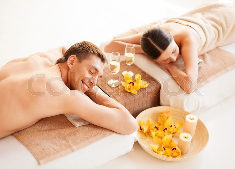 Stock image of 'picture of couple in spa salon lying on the massage desks'