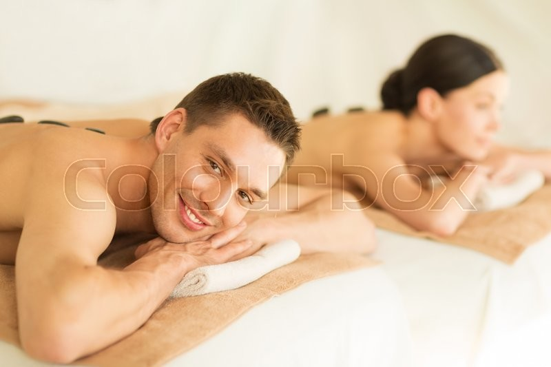 Stock image of 'picture of couple in spa salon with hot stones'