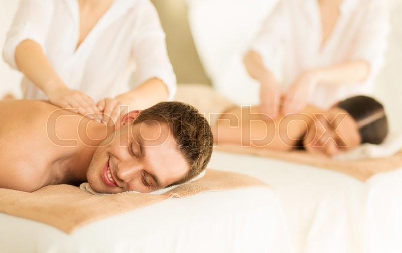 Stock image of 'picture of couple in spa salon getting massage'