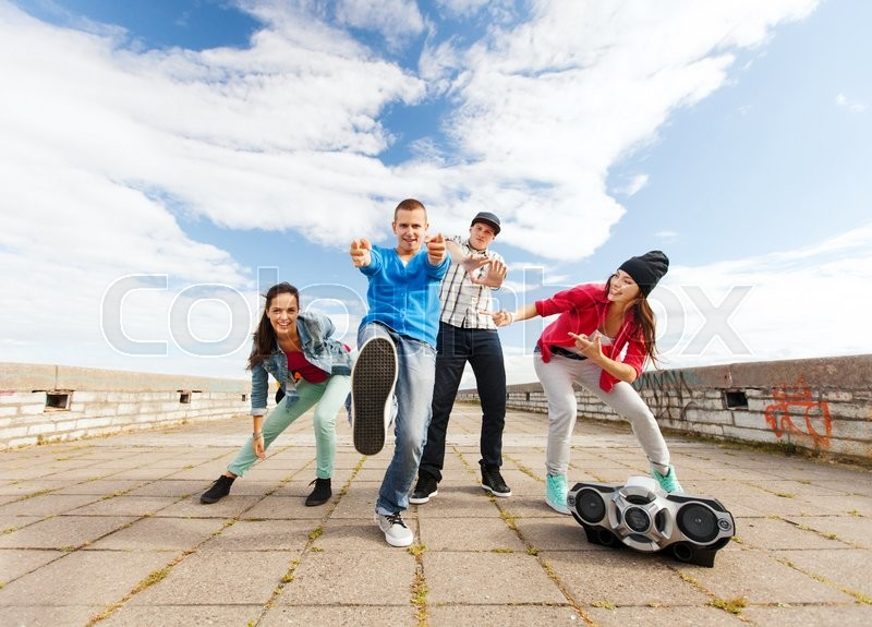 Stock image of 'sport, dancing and urban culture concept - group of teenagers dancing'