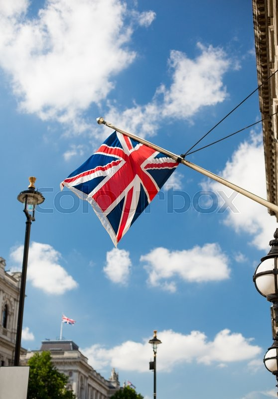 Stock image of 'state sybols and national holidays concept - british nion jack flag waving on london city street'
