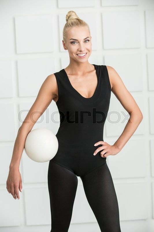 Stock image of 'Studio portrait of a pretty rhythmic gymnastics with white ball.'