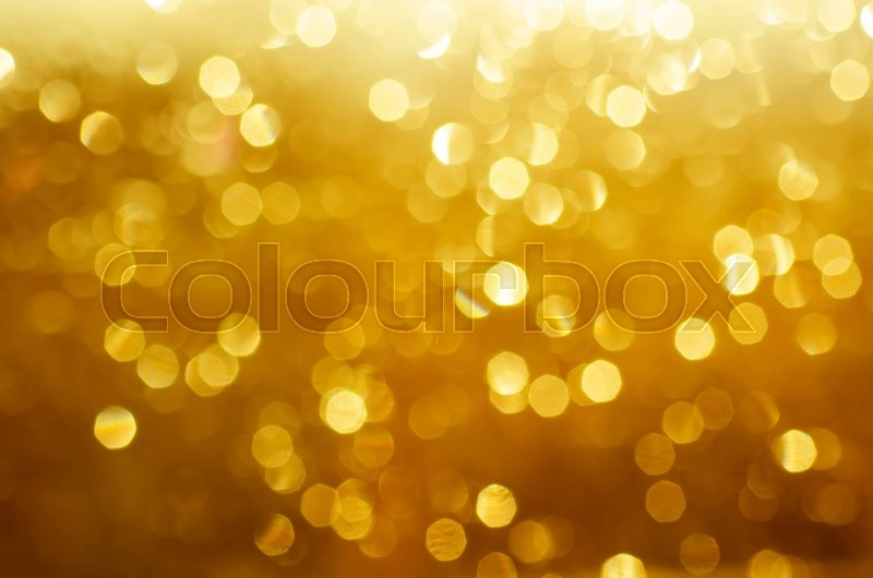 Stock image of 'Natural outdoors bokeh  in golden autumn tones, seasonal abstract blurred sunny background'
