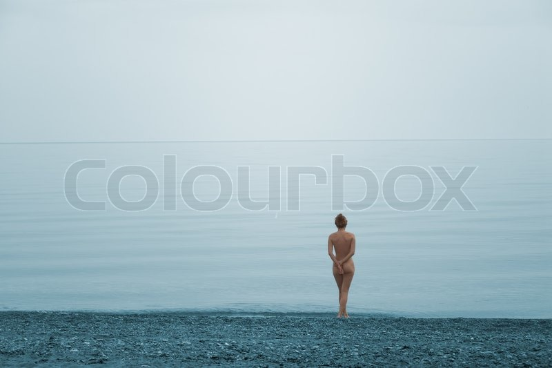 Stock image of 'Lonely naked girl on the beach of quite sea'