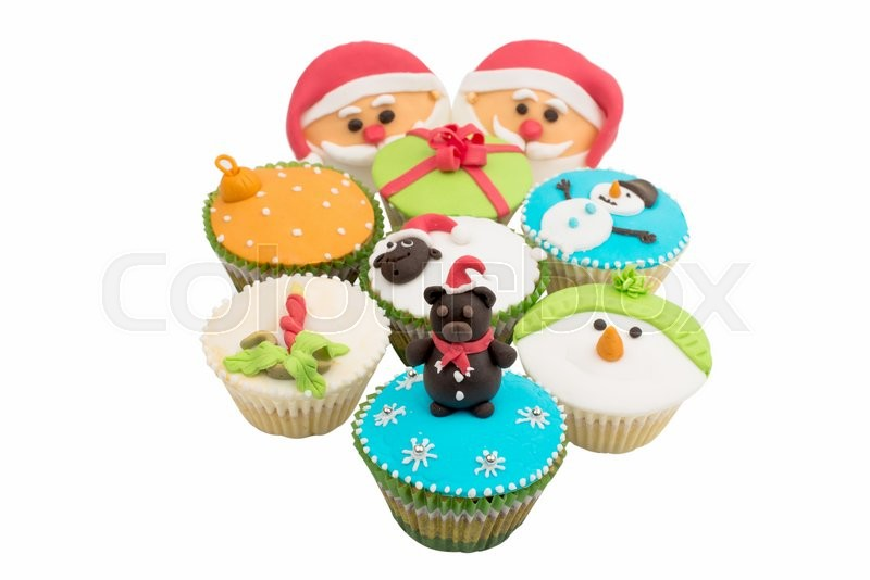 Stock image of 'Christmas cupcakes on a white background'