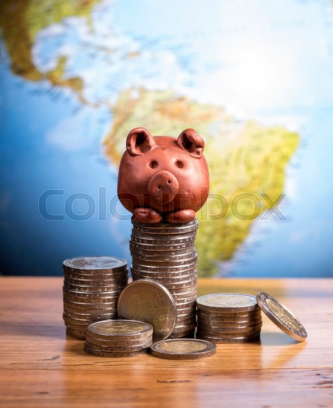 Stock image of 'Brown piggy bank and coins, with earth background.'