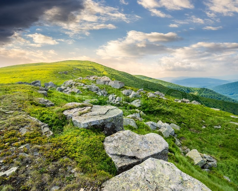 Stock image of 'landscape with white sharp boulders on the hillside near mountain peak'