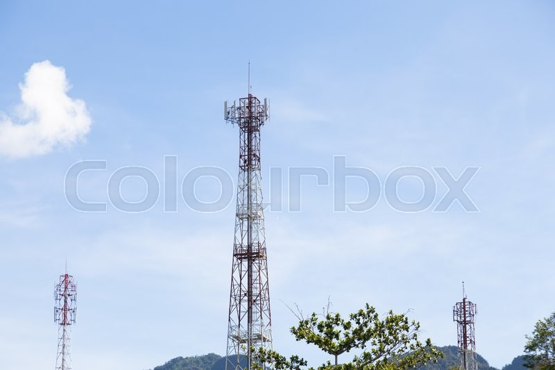 Stock image of 'Phone antenna.The transmission poles in the area. Behind the clear skies'