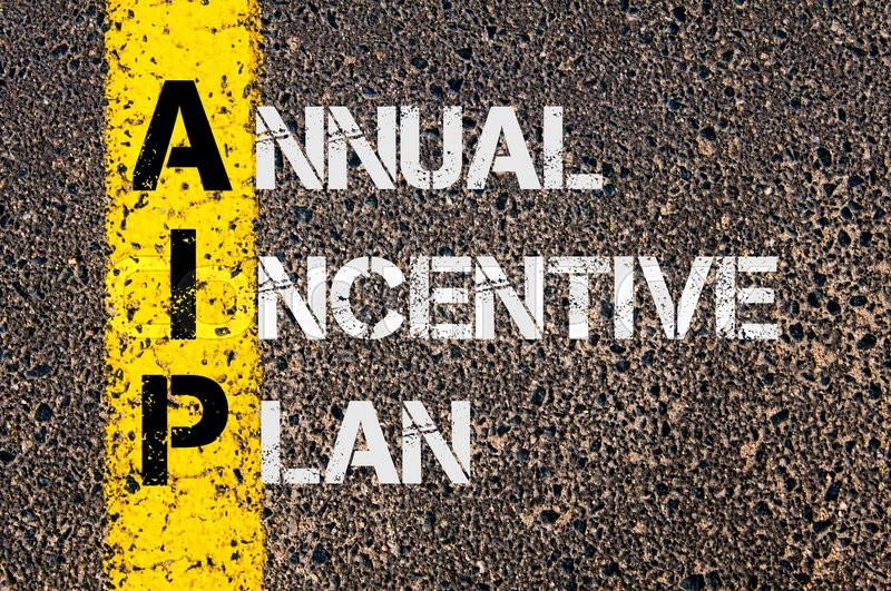Stock image of 'Concept image of Business Acronym AIP as Annual Incentive Plan  written over road marking yellow paint line.'