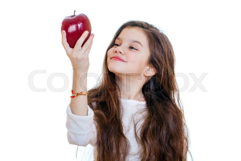 Stock image of 'Portrait of a beautiful little girl holding a red apple, isolated on white background'