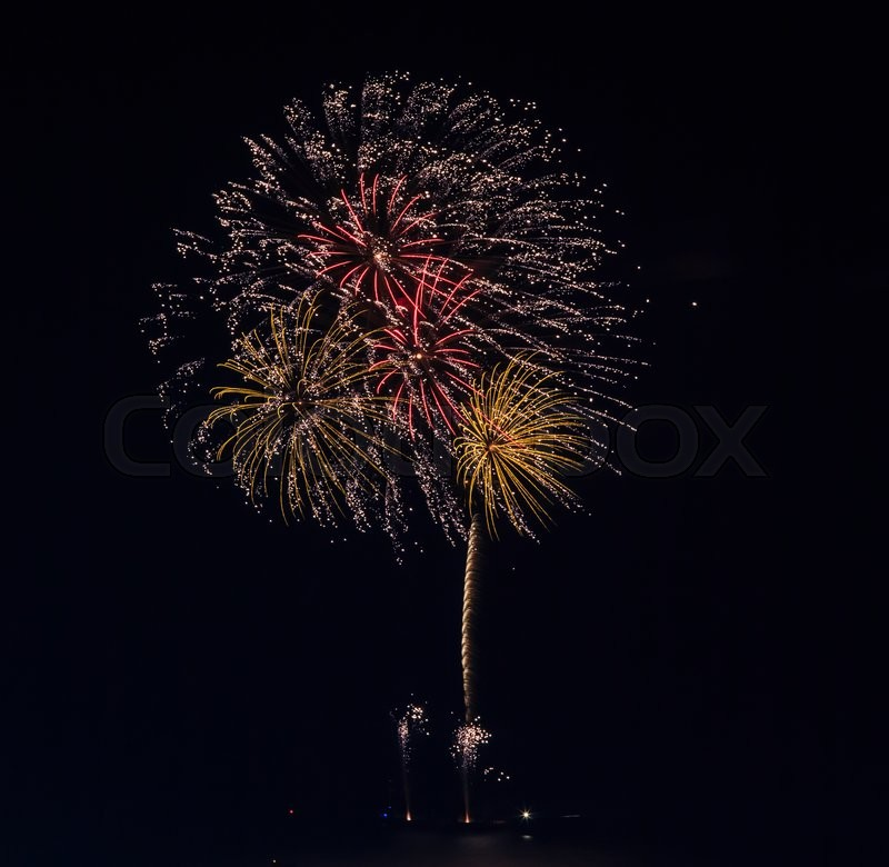 Stock image of 'Beautiful colorful holiday fireworks on the black sky background'