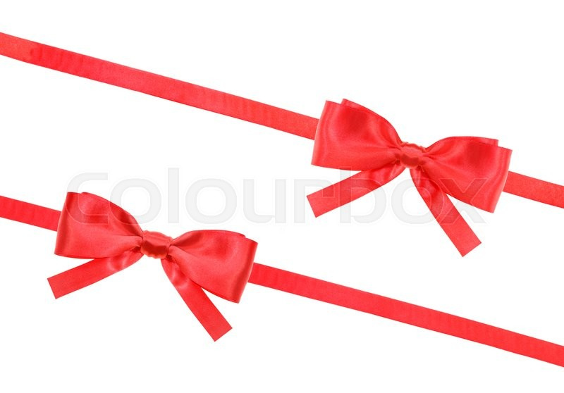 Stock image of 'two big red satin bows and two diagonal ribbons isolated on horizontal white background'