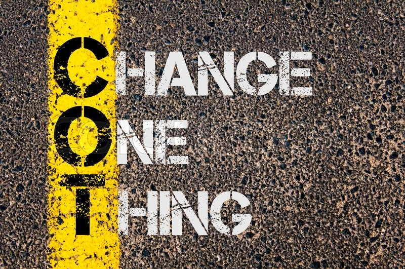 Stock image of 'Concept image of Business Acronym  COT as Change One Thing  written over road marking yellow paint line.'