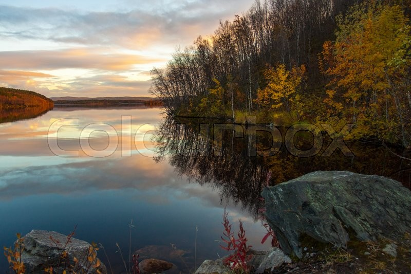Stock image of 'Beautiful sunset over the forest lake'
