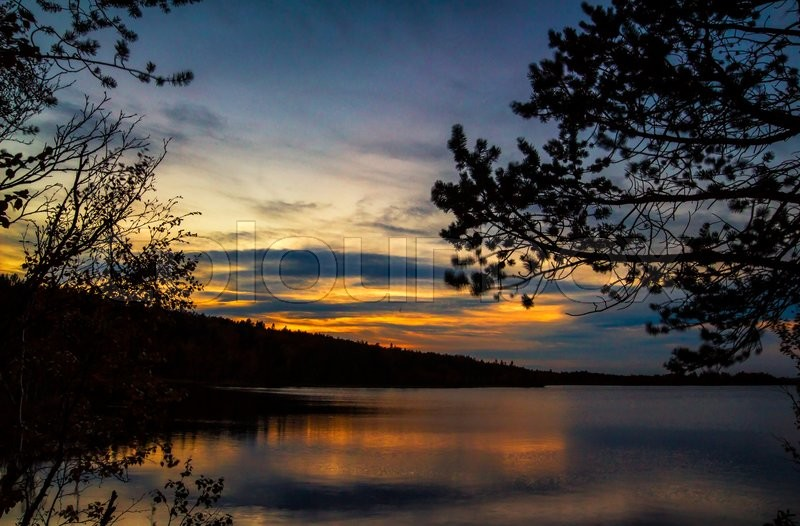 Stock image of 'Beautiful sunset on the lake in the North woods'