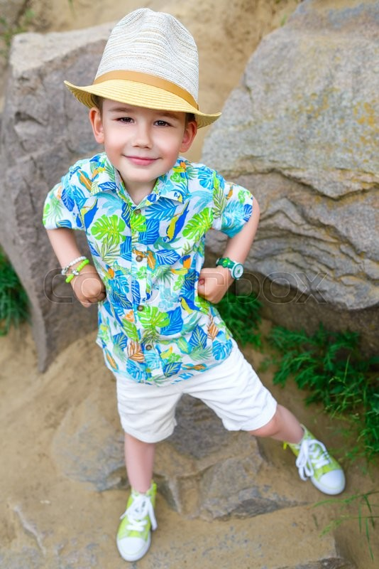 Stock image of 'Young traveler in hat over stone background.'