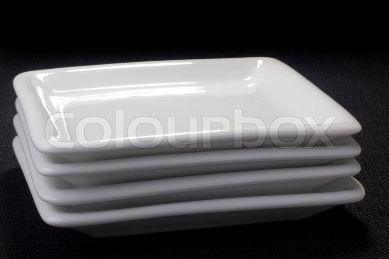 White square ceramic plates for dessert dishes on a black background. | Stock Photo | Colourbox & White square ceramic plates for dessert dishes on a black background ...