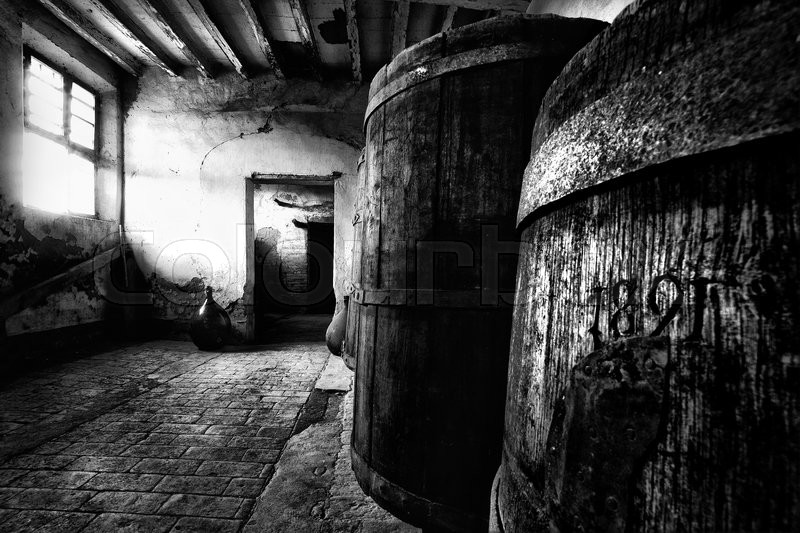 Stock image of 'A very old barrels inside an abandoned countryhouse.'