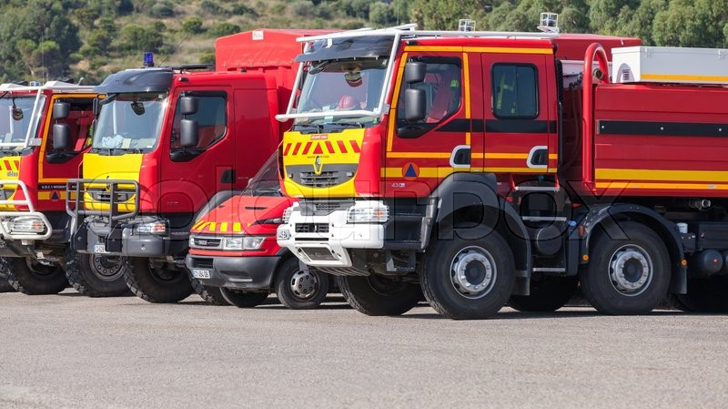 Editorial image of 'Propriano, France - July 4, 2015: Renault trucks of French civil security military formations stands in a row. French Government civil defence agency transport on parking'