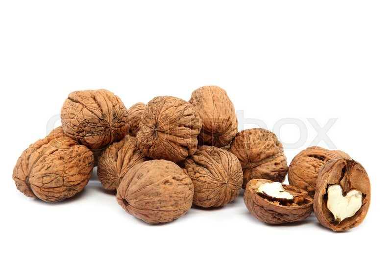 Stock image of 'Handful walnuts isolated on a white background.'
