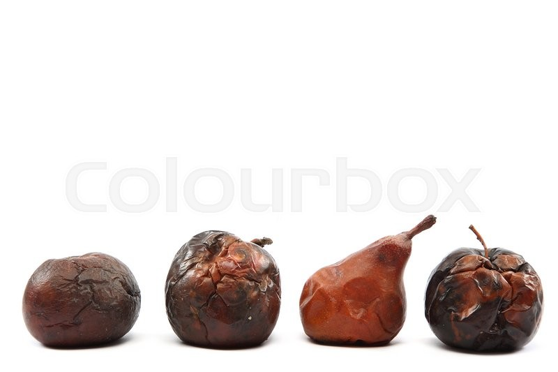 Stock image of 'Rotten apples and pear isolated on white background.'