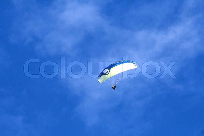 Stock image of 'Paragliding in the blue sky '