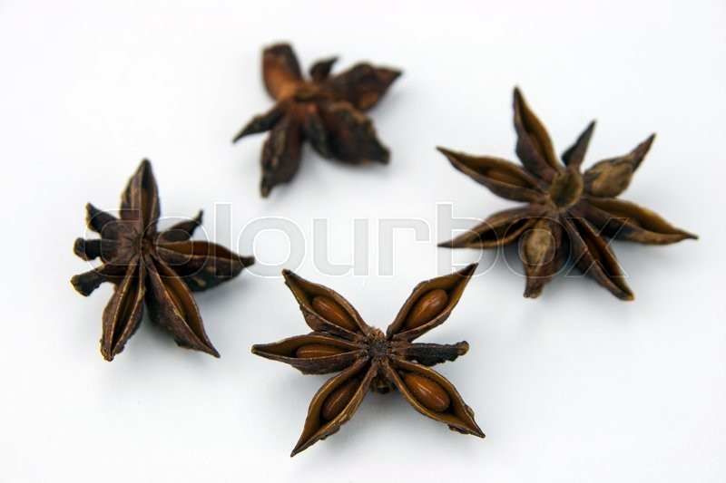 Stock image of 'Anise star (Illicium verum) isolated on white background. Also called Star aniseed, or Chinese star anise. Used as a spice in cuisines all over the world. The plant is also used in medicine.'