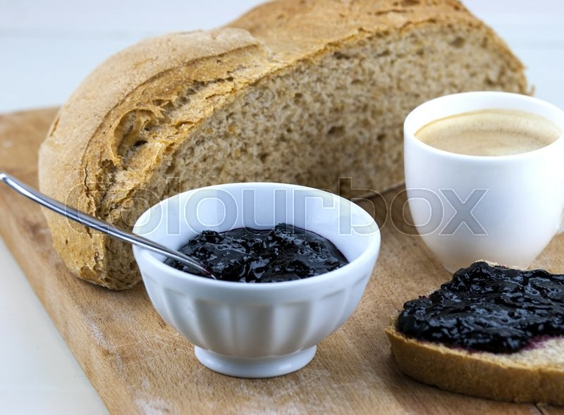 Stock image of 'Homemade blueberry jam with integral bread and coffe'