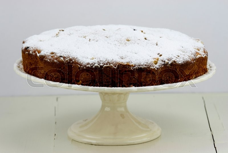 Stock image of 'Italian cake with ricotta, pears and drops of chocolate on white wooden table.'