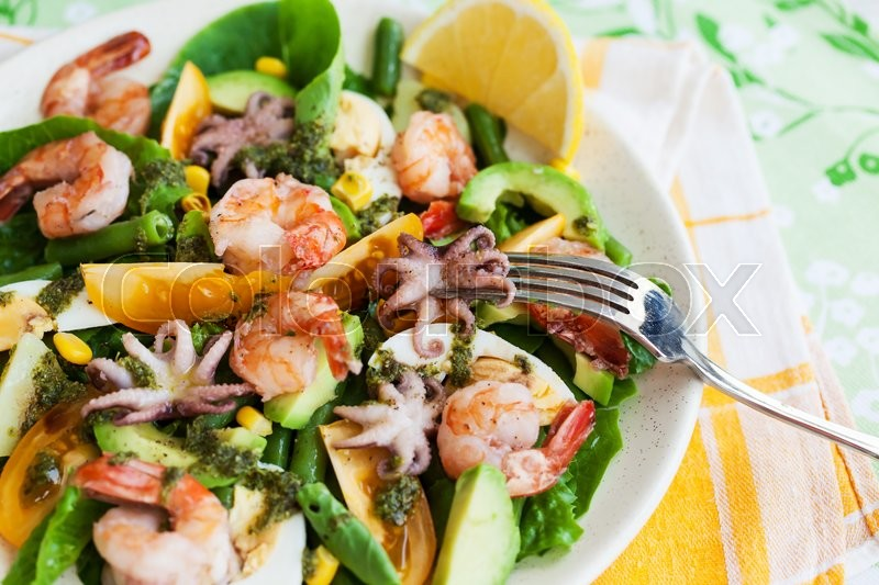 Stock image of 'Fresh prawns, octopus, eggs and vegetables salad for lunch'