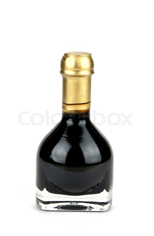Stock image of 'Traditional italian balsamic vinegar inside a special bottle isolated on white background'