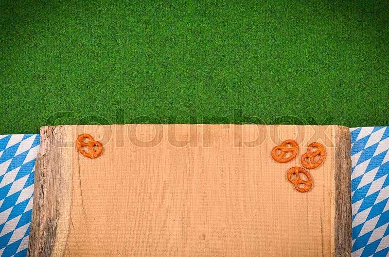 Stock image of 'Oktoberfest background with the Bavarian flag and pretzel'