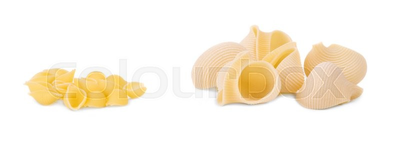 Stock image of 'Uncooked italian pasta. Isolated on a white background.'