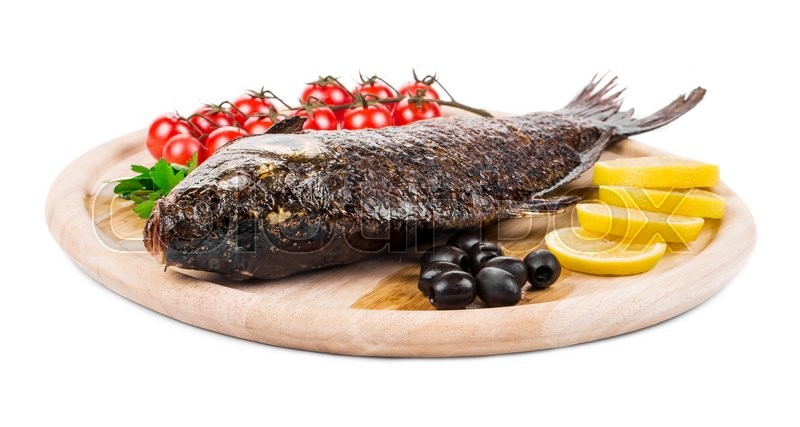 Stock image of 'Fried carp on wooden platter. Isolated on a white background.'