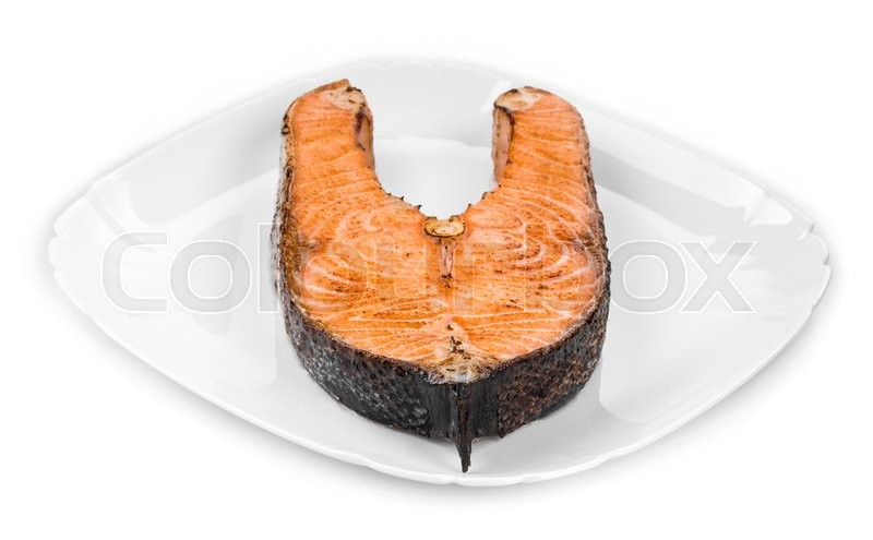 Stock image of 'Fresh grilled salmon steak. Isolated on a white background.'