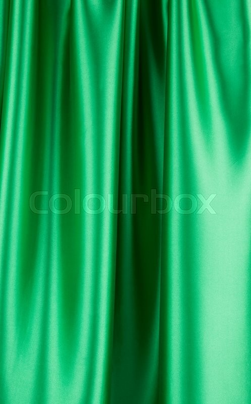 Stock image of 'Green silk cloth with soft folds. Whole background.'