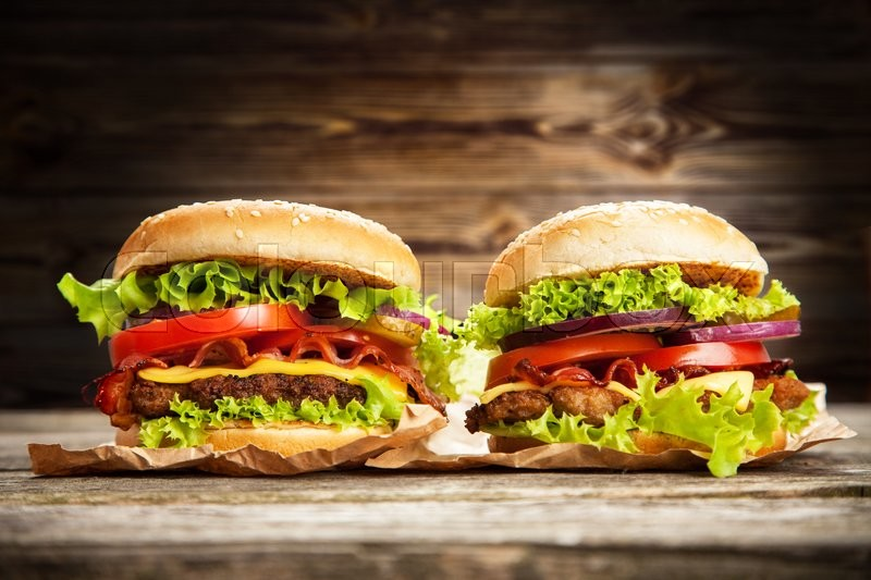 Stock image of 'Delicious hamburgers on wooden background'