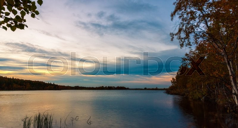 Stock image of 'Sunset in forest lake in autumn'