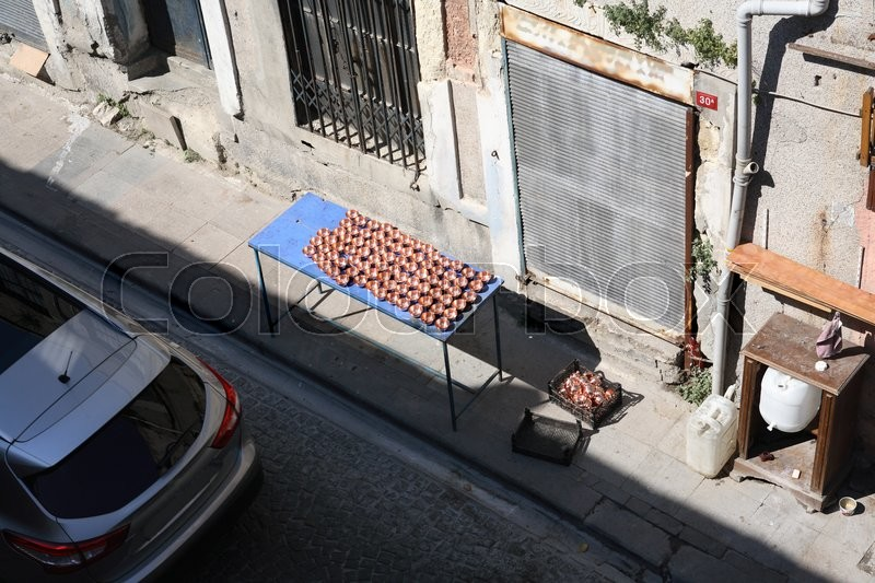 Stock image of 'Small business. Table with small metal cups on alleyway in Istanbul, Turkey'