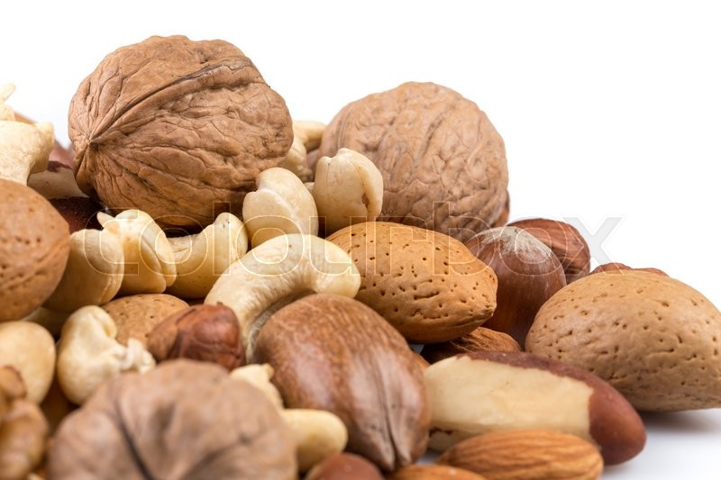 Stock image of 'Variety of Mixed Nuts Isolated on White Background'