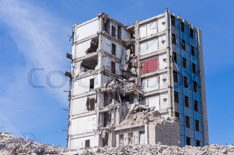 Stock image of 'Pieces of Metal and Stone are Crumbling from Demolished'